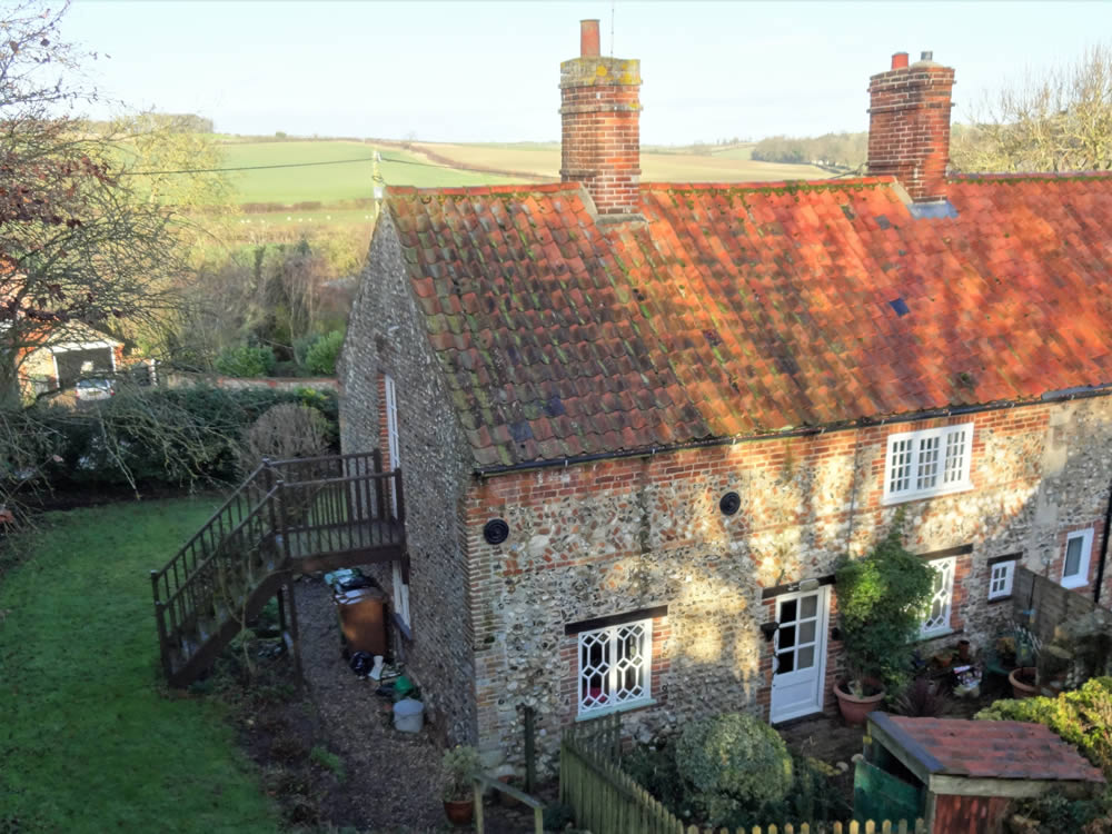 Survey of Grade II Listed Flint and Brick Cottage in North Norfolk